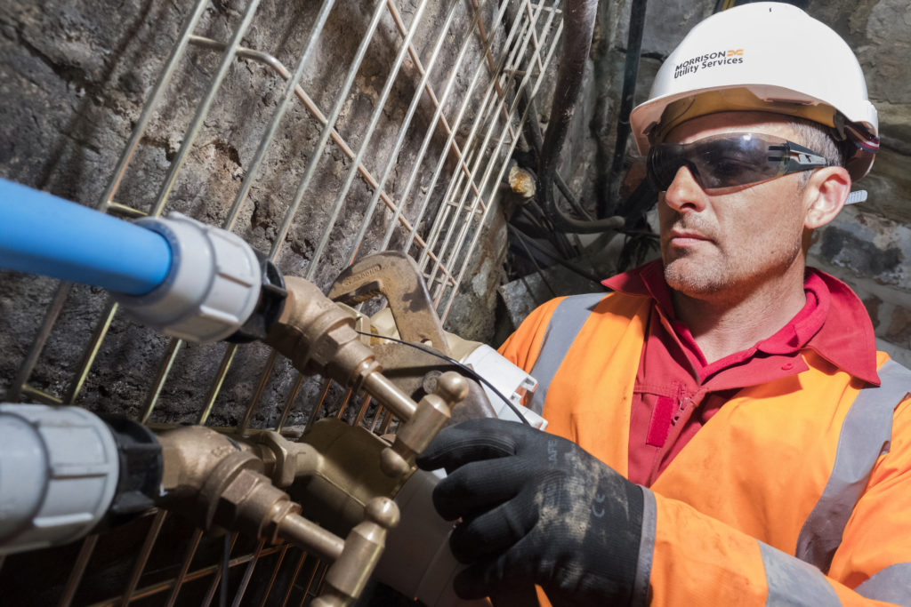 A Morrison Utility Services technican repairing a water pipe