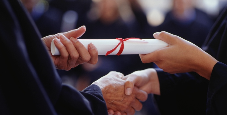 Graduate receiving diploma, Close-up of hands